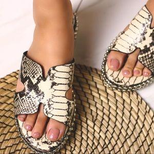 Snake printed studded sandal